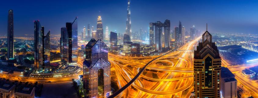 Dubai Skyline At Night, Panoramic Aerial Top View To Downtown Ci
